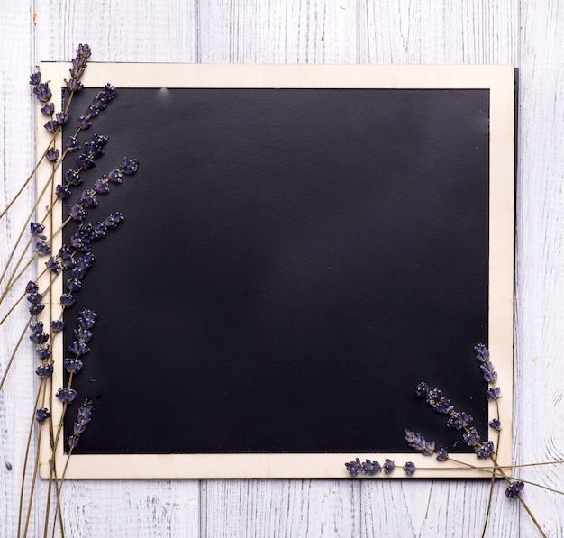 Chalk board with branches seal