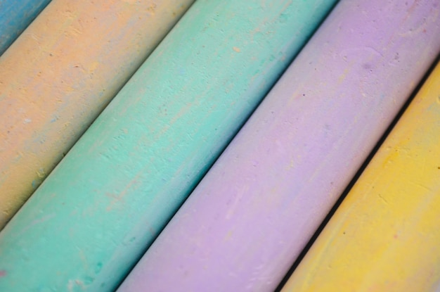Chalk for drawing multicolored white, pink, blue, yellow, green on a white background.