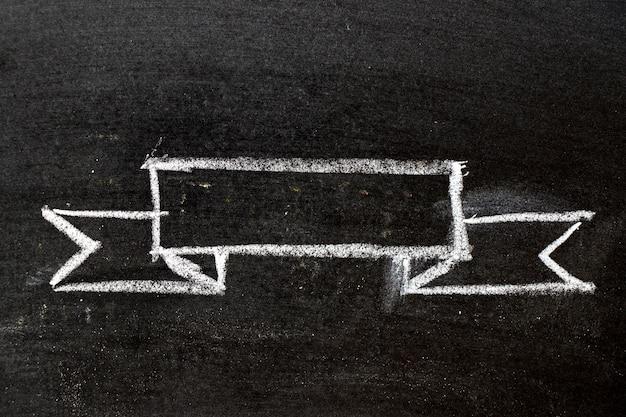 Chalk drawing ribbon on slate surface