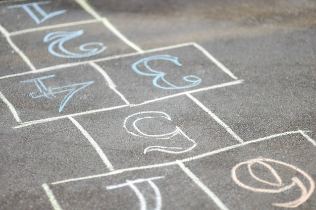Chalk-painted hopscotch on asphalt