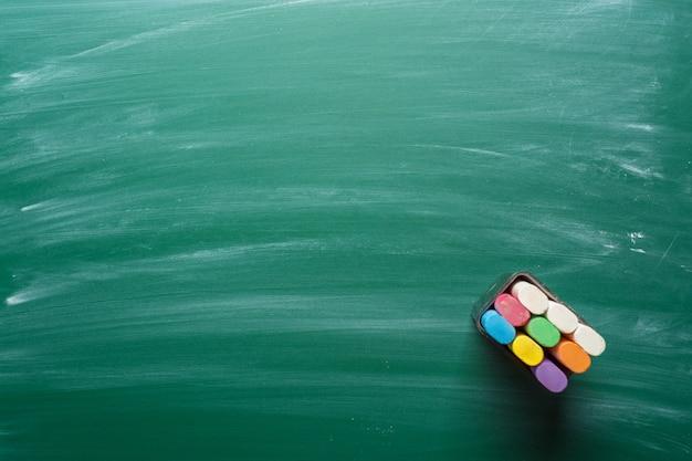 Chalk pieces on a chalkboard