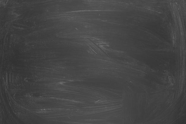 Фон классной доски. текстура черная доска со следами мела