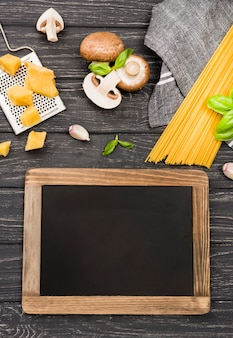 Chalkboard beside spaghetti with mushrooms