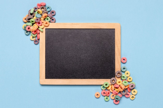Chalkboard and cereals with copy space background