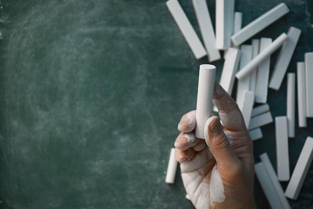 Chalkboard. crayons for writing on a blackboard. learning concept. school teaching chalk board.