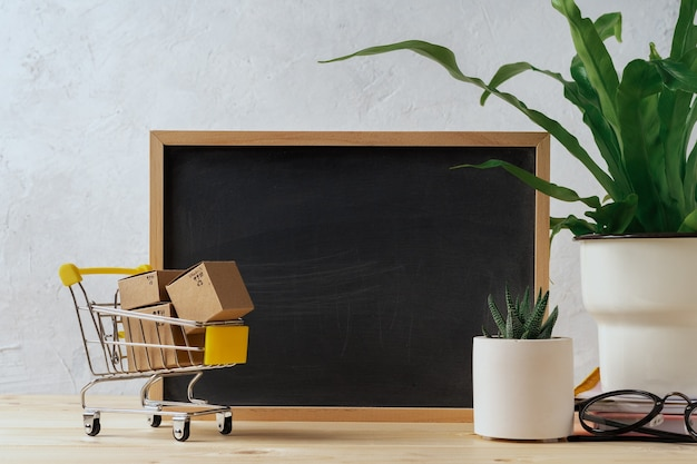Chalkboard frame with shopping cart and boxes
