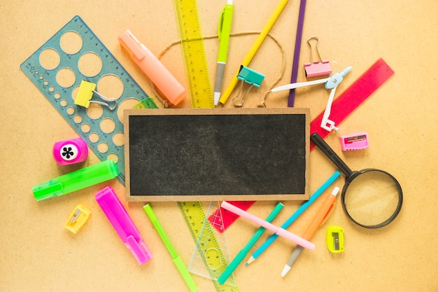 Chalkboard lying on stationery
