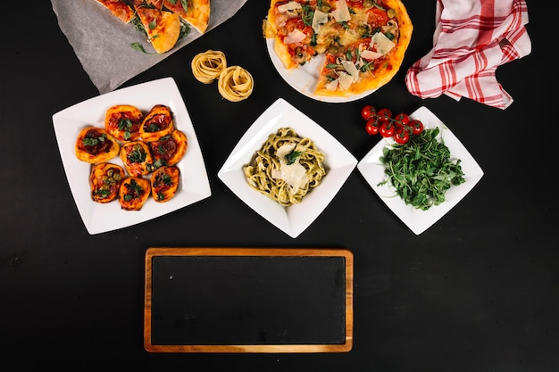 Chalkboard near italian dishes