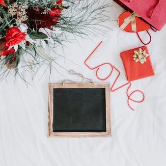 Chalkboard near love writing and presents