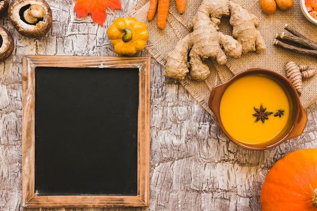 Chalkboard near soup and ingredients