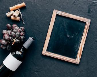 Chalkboard near wine and grape
