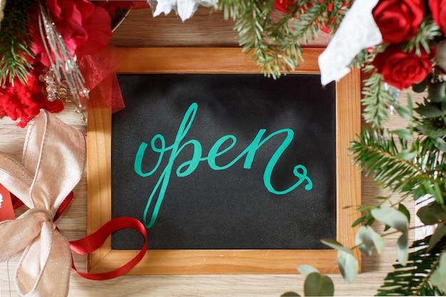 Chalkboard open inside a flower shop during holiday winter season