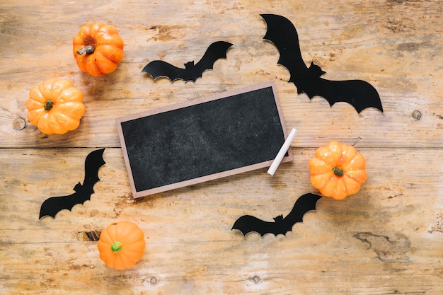 Chalkboard and paper bats with pumpkins