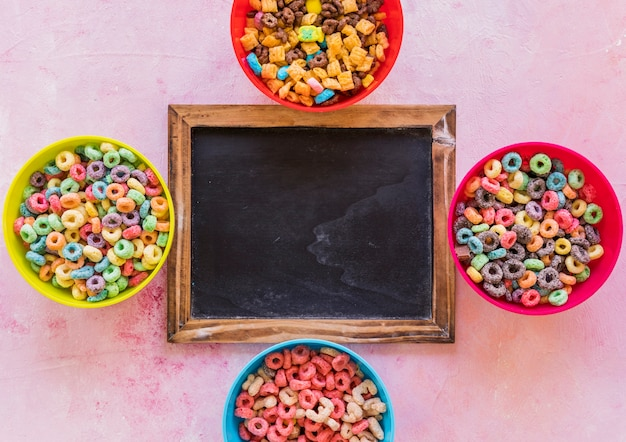 Chalkboard with bowls of cereals on table