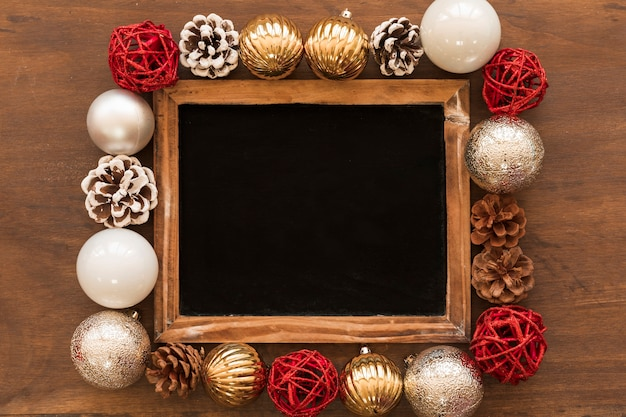 Chalkboard with bright baubles on table