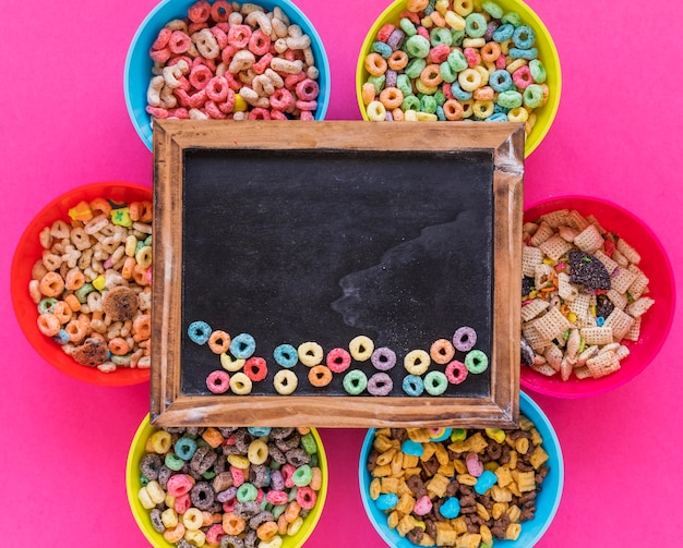 Chalkboard with cereals on bright bowls