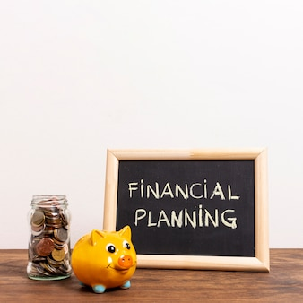 Chalkboard with financial planning text and money