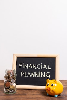 Chalkboard with financial planning text and a piggy bank