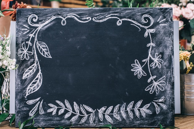 Chalkboard with ornamental pattern and empty space