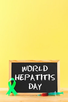 Chalkboard with text world hepatitis day.
