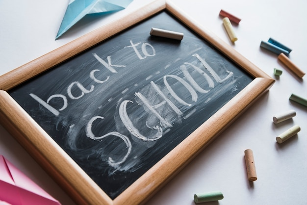 Chalkboard with white back to school sign