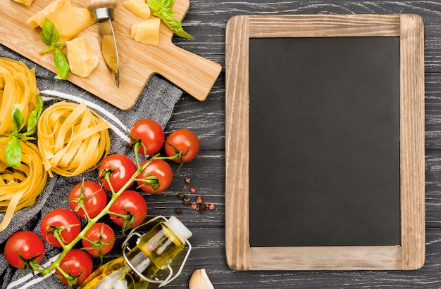 Chalkboard and wooden board with ingredients