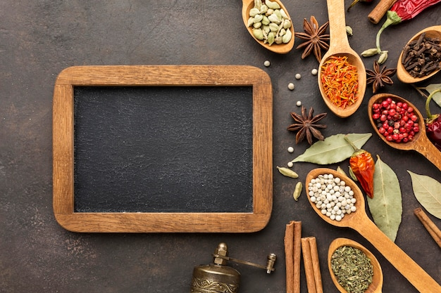 Chalkboard and wooden spoon with spices