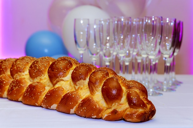 Challah bread with sesame seeds , selective focus