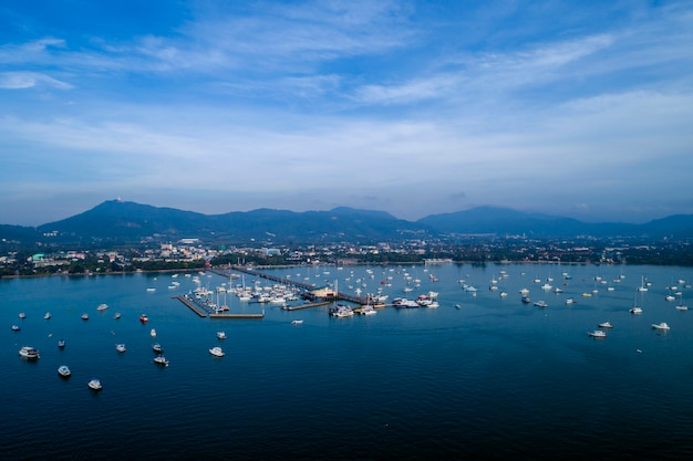 Chalong pier with sailboats for travel image by drone flying shot