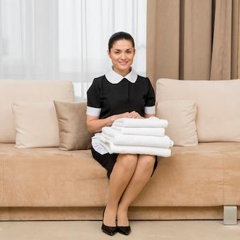 Chambermaid in hotel room