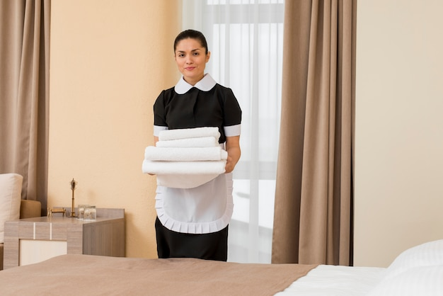 Chambermaid in hotel room