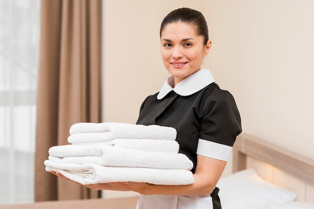 Chambermaid preparing hotel room