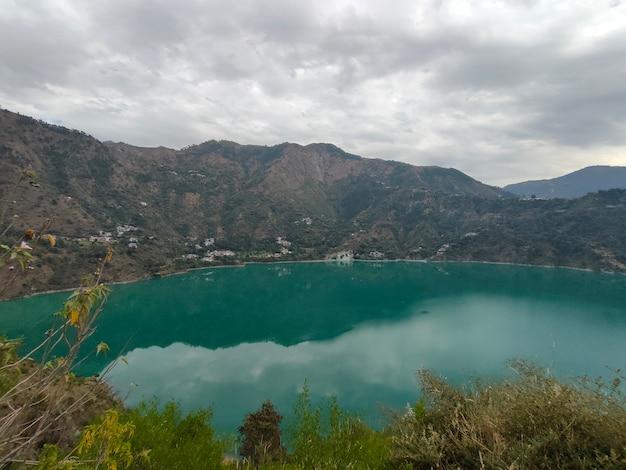 Chamera lake in dalhousie himachal india lake in a mountain range