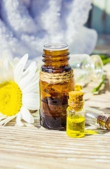 Chamomile essential oil. selective focus. butle little.