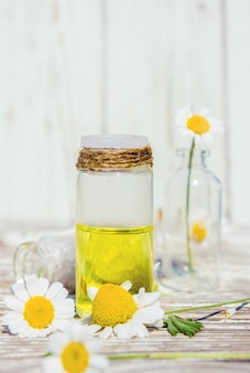 Chamomile extract in a small bottle. selective focus.