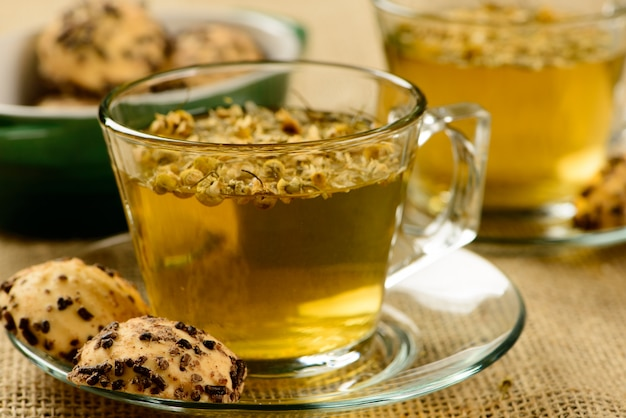 Chamomile tea cup with crackers