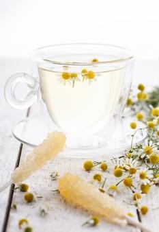 Chamomile tea in a glass.