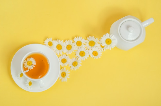 Chamomile tea is poured into a cup.