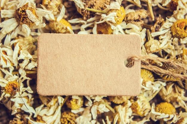 Chamomile tea and tag. selective focus. nature.