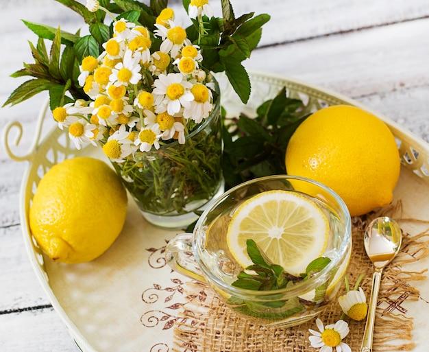 Chamomile tea with lemon and mint. herbal tea. dietary menu. proper nutrition.