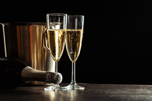 Champagne on the black background