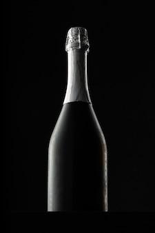 Champagne bottle on black