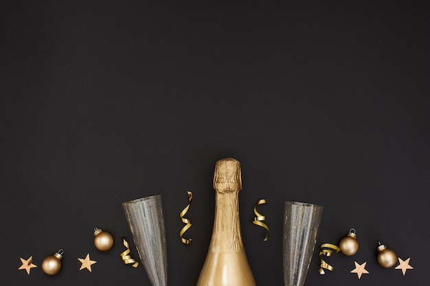 Champagne bottle and decoration with glasses and copy space