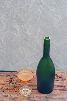 Champagne bottle of frozen fruit on glass, top view