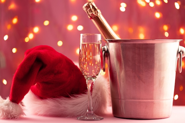 Champagne bottle and glass against bokeh lights background