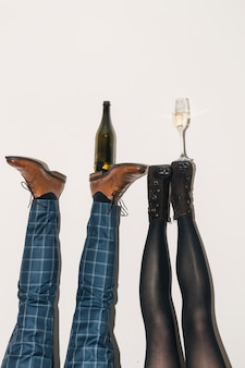 Champagne bottle and glass on feet