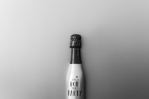 Champagne bottle on grey background