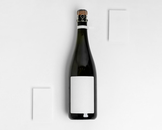 Champagne bottle on white background top view