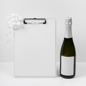 Champagne bottle with clipboard