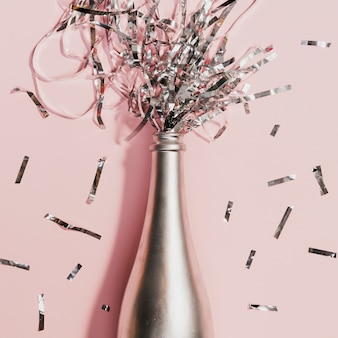 Champagne bottle with confetti at new years party